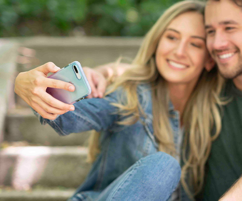 Harmony case on iPhone 12 with couple taking selfie