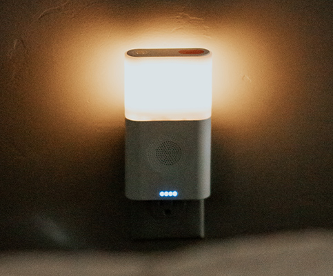 Wall-mounted night light with power bank and fm radio speaker.