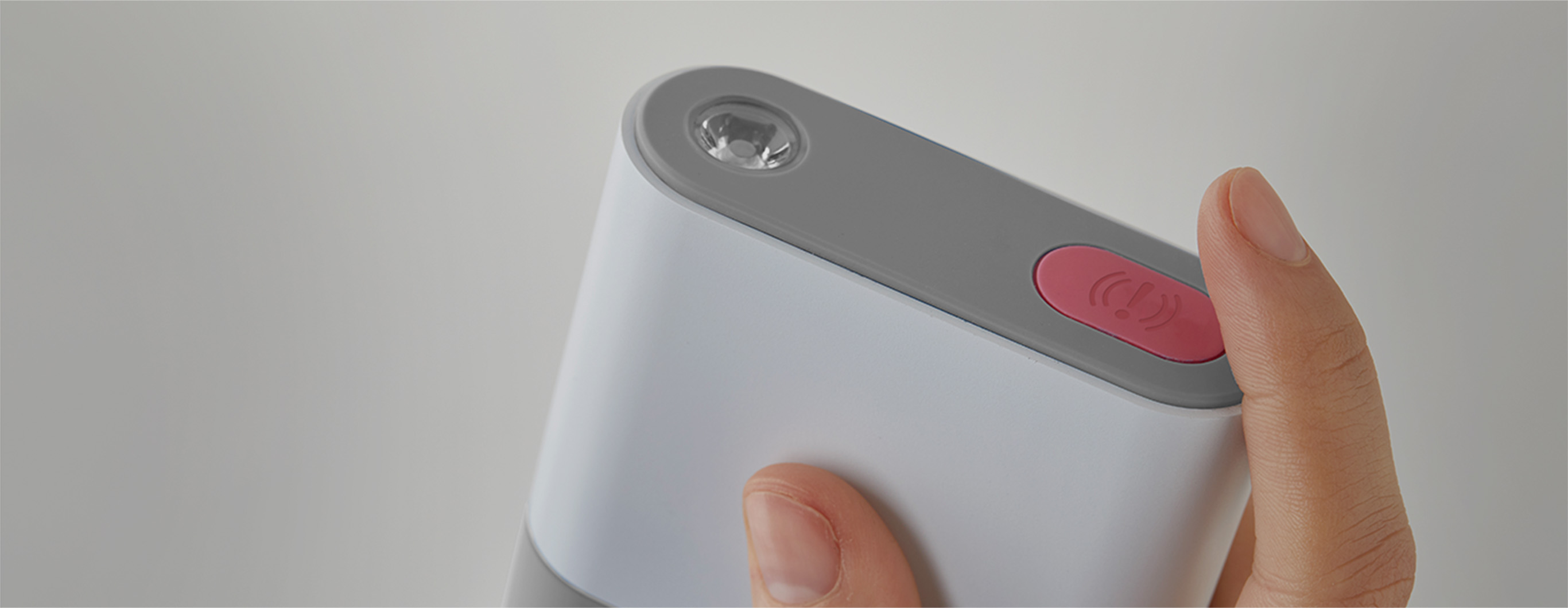 Person holding their phone and a 5-in-1.
