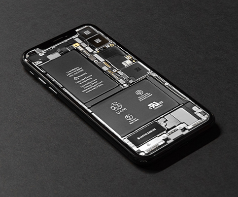 Exposed iPhone components featuring lithium-ion battery, taptic engine